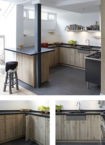 Eiken keuken met witte olie en was afgewerkt. Zwart granieten blad en ...